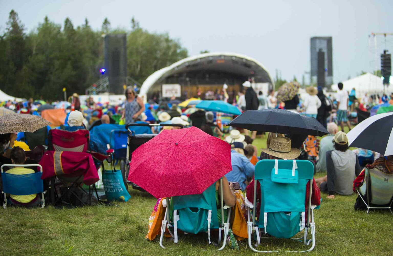 People enjoy the Winnipeg Folk Festival despite the brief spot of rain at Birds Hill Provincial Park on Saturday, July 11, 2015.   Mikaela MacKenzie / Winnipeg Free Press (Winnipeg Free Press)
