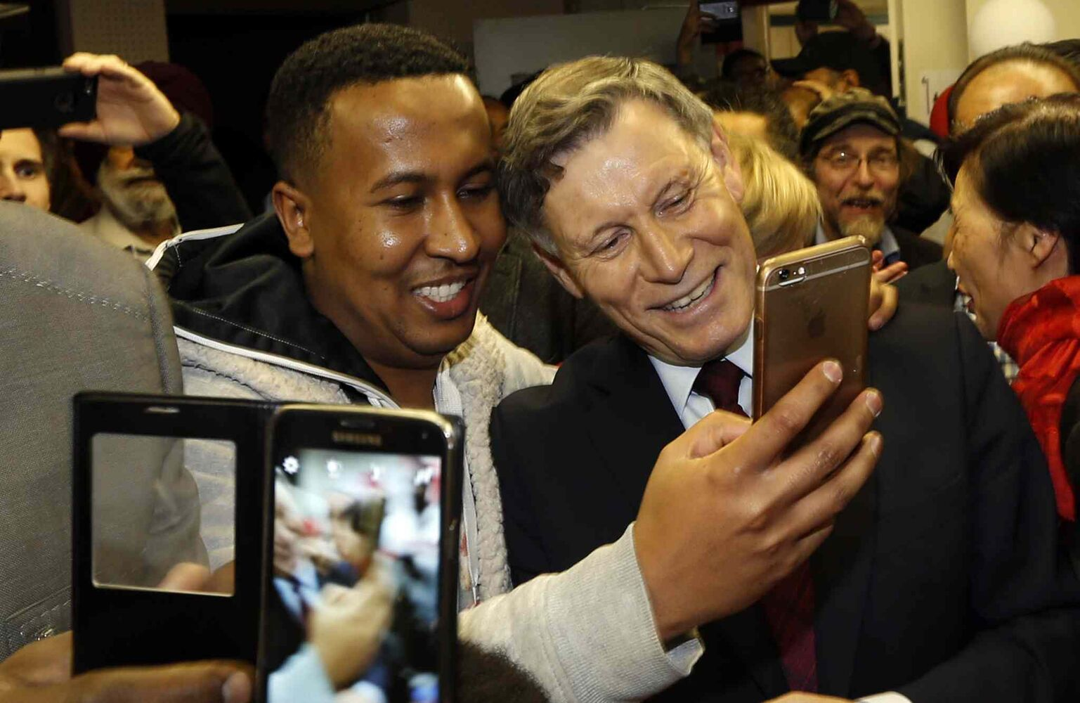 At right, Liberal candidate Terry Duguid poses for a picture with supporters at his Winnipeg South HQ after he was elected Monday night. (Wayne Glowacki / Winnipeg Free Press)