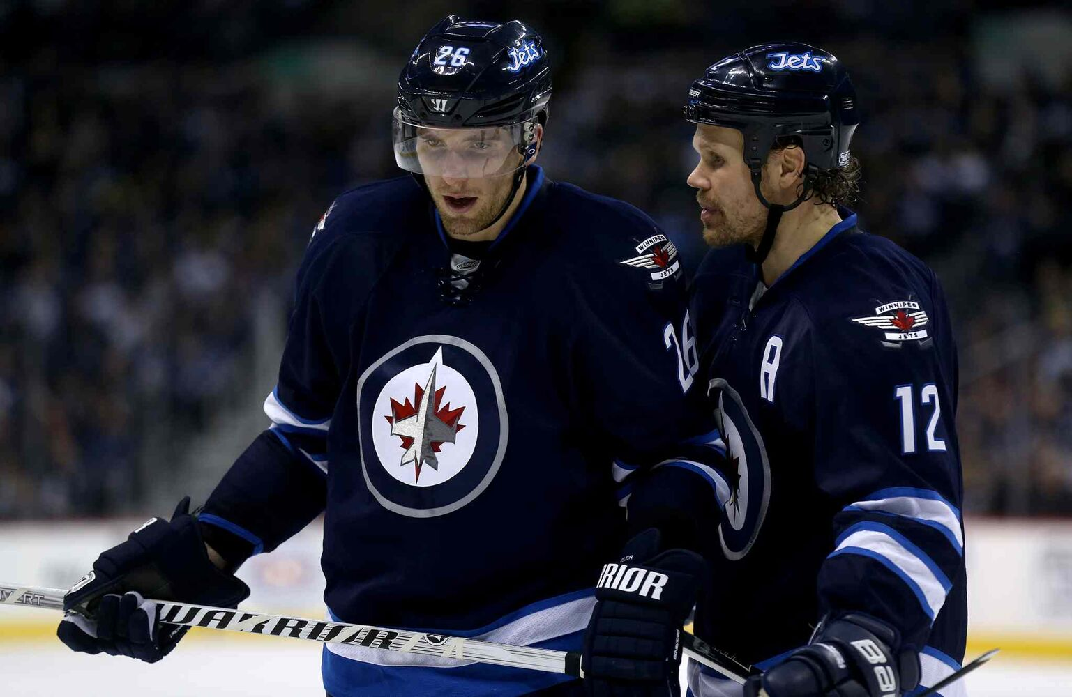 Winnipeg Jets' Blake Wheeler (26) and Olli Jokinen (12) skate together during second period hockey action against the Columbus Blue Jackets' at MTS Centre Saturday. (Trevor Hagan / Winnipeg Free Press)