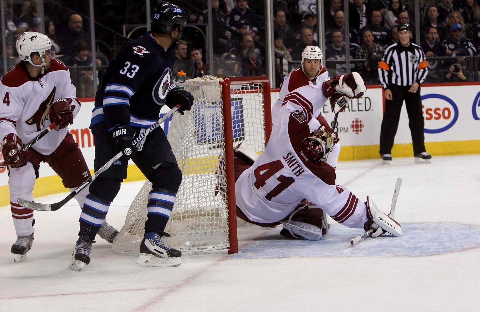 Phoenix Coyotes' goalie Mike Smith (41) trips after Winnipeg Jets' Bryan Little's (18) unassisted second-period shot sails past him. (Ruth Bonneville / Winnipeg Free Press)