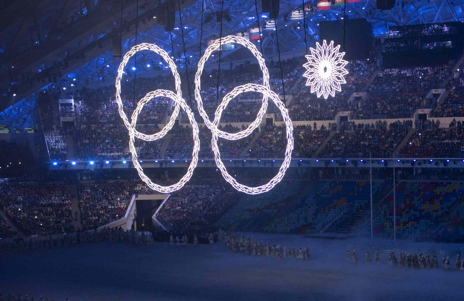 An Olympic rings fails to open during opening ceremonies at the Sochi Winter Olympics Friday, February 7, 2014 in Sochi. THE CANADIAN PRESS/Paul Chiasson