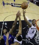 Los Angeles Clippers' DeAndre Jordan (6) is defended by San Antonio Spurs' Tim Duncan, center, and Kawhi Leonard (2) as he tries to score during the first half of Game 4 in an NBA basketball first-round playoff series, Sunday, April 26, 2015, in San Antonio. (AP Photo/Darren Abate)