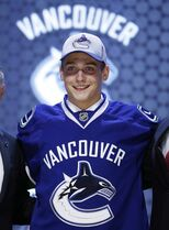 Jake Virtanen wears a Vancouver Canucks sweater after being chosen sixth overall during the first round of the NHL hockey draft, Friday, June 27, 2014, in Philadelphia. The Canucks have signed sixth-overall draft pick Virtanen. THE CANADIAN PRESS/AP/Matt Slocum