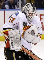 Calgary Flames goalie Karri Ramo makes a save during the second period of the NHL hockey game against the New York Islanders, Friday, Feb. 27, 2015, in Uniondale, N.Y. (AP Photo/Seth Wenig)