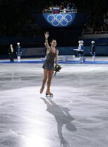 Adelina Sotnikova of Russia waves to spectators after placing first in the results area after completing her routine in the women's free skate figure skating finals at the Iceberg Skating Palace during the 2014 Winter Olympics, Thursday, Feb. 20, 2014, in Sochi, Russia. (AP Photo/Bernat Armangue)