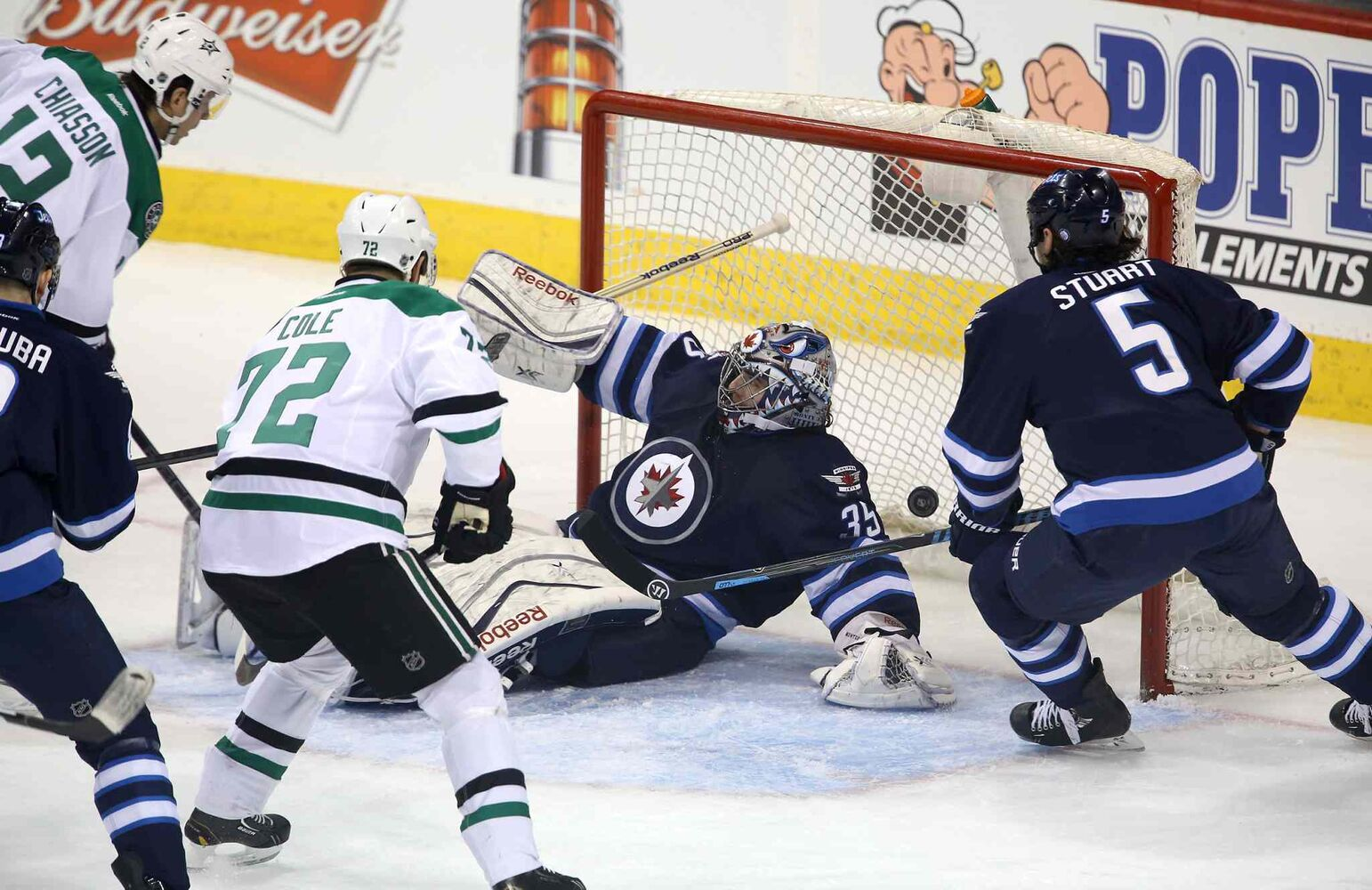 The Dallas Stars Alex Chiasson (12) scores on Winnipeg Jets goaltender Al Montoya in the first period. (TREVOR HAGAN / THE CANADIAN PRESS)
