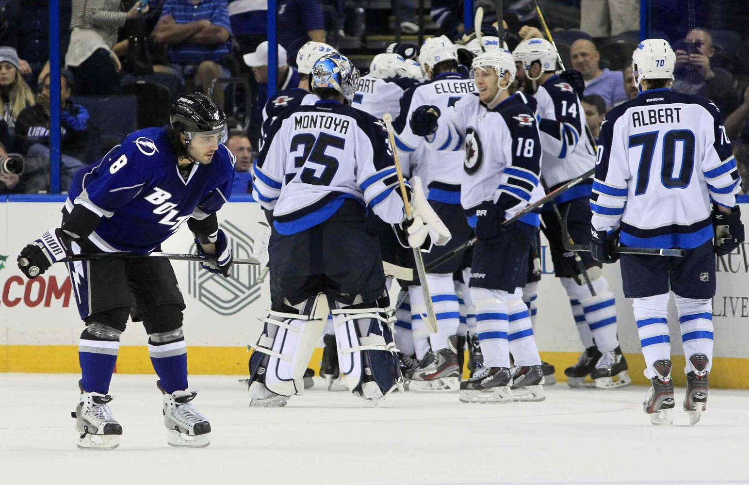 The Tampa Bay Lightning's Mark Barberio (left) skates off as the Winnipeg Jets celebrate their game-winning overtime goal for a 2-1 win. (Dirk Shadd / Tampa Bay Times / MCT)