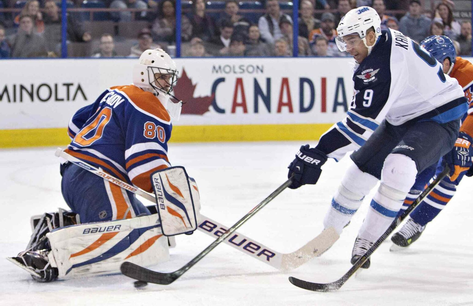 Winnipeg Jets' Evander Kane (9) is stopped by Edmonton Oilers goalie Ilya Bryzgalov (80) during first period NHL hockey action in Edmonton, Alta., on Monday. (Jason Franson / The Canadian Press)