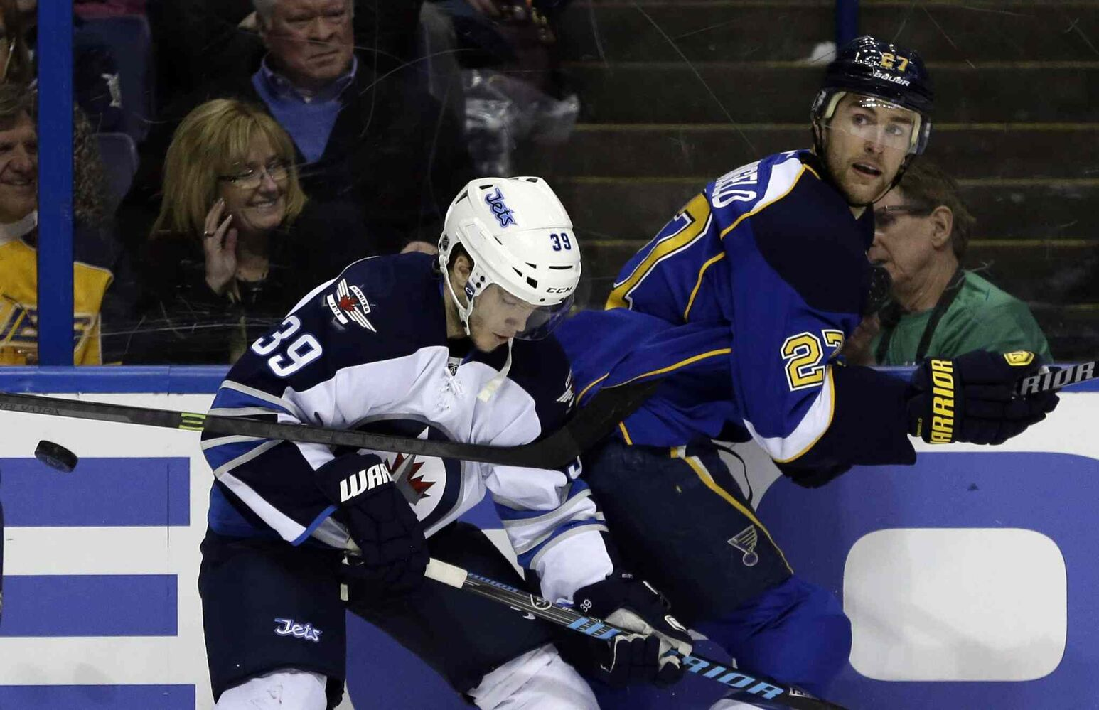 Jets defenceman Tobias Enstrom and Blues defenceman Alex Pietrangelo chase after a loose puck in the second period. (JEFF ROBERSON / THE ASSOCIATED PRESS)