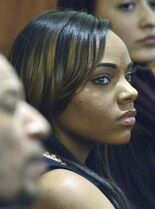 FILE - In this March 6, 2015, file photo, Shayanna Jenkins, fiancee of former New England Patriots football player Aaron Hernandez, listens during Hernandez's murder trial in Fall River, Mass. Two people with knowledge of the matter told The Associated Press that Jenkins will be called to testify in his murder trial on Friday, March 27, 2015, (AP Photo/The Boston Herald, Ted Fitzgerald, Pool, File)