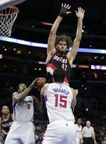 Los Angeles Clippers' Hedo Turkoglu (15) of Turkey, passes the ball to DeAndre Jordan under pressure by Portland Trail Blazers' Robin Lopez (42) during the first half of an NBA basketball game Wednesday, March 4, 2015, in Los Angeles. (AP Photo/Jae C. Hong)