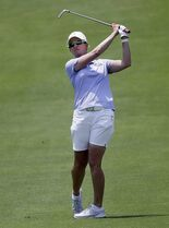 Karrie Webb, of Australia, watches an approach shot on the 18th hole during the third round of the LPGA North Texas Shootout golf tournament, Saturday, May 2, 2015, in Irving, Texas. (AP Photo/LM Otero)