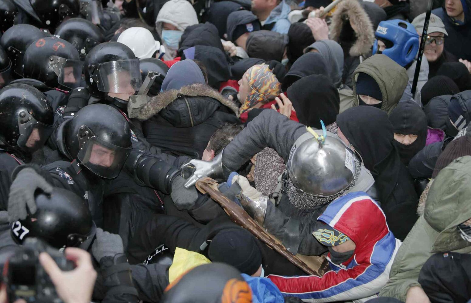 Protesters clash with police at Presidential office in Kiev, Ukraine, on Sunday. As many as 100,000 demonstrators chased away police to rally in the center of Ukraine's capital on Sunday, defying a government ban on protests on Independence Square, in the biggest show of anger over the president's refusal to sign an agreement with the European Union.  (Efrem Lukatsky / The Associated Press)