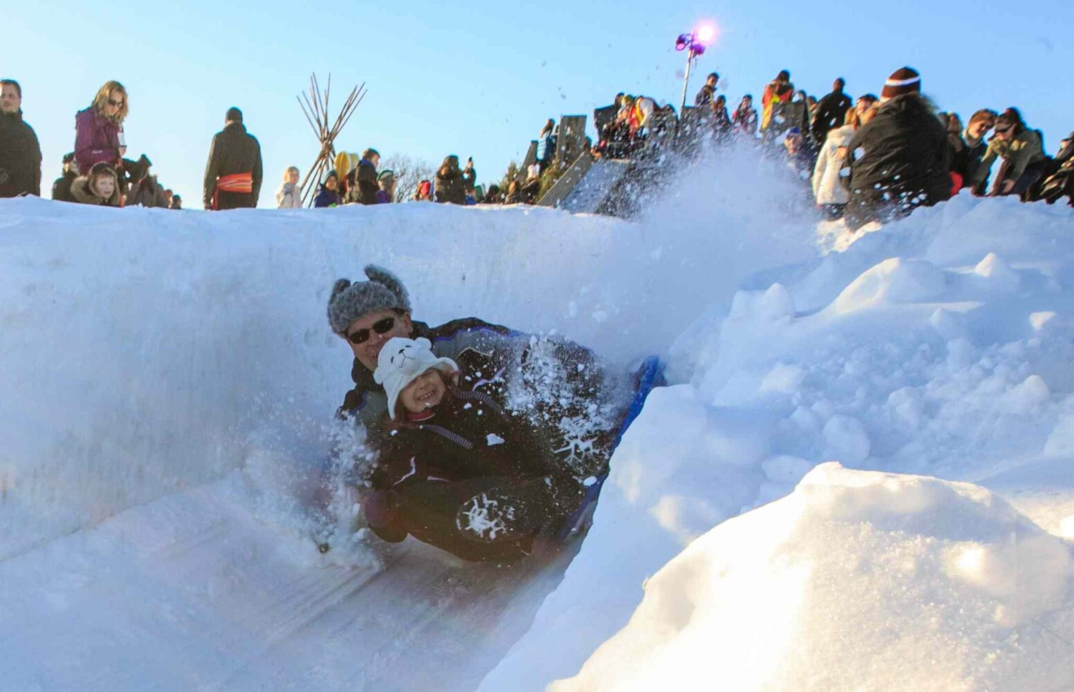 Tobogganers lose their sleds at Festival du Voyageur snow park on Louis Riel Day.