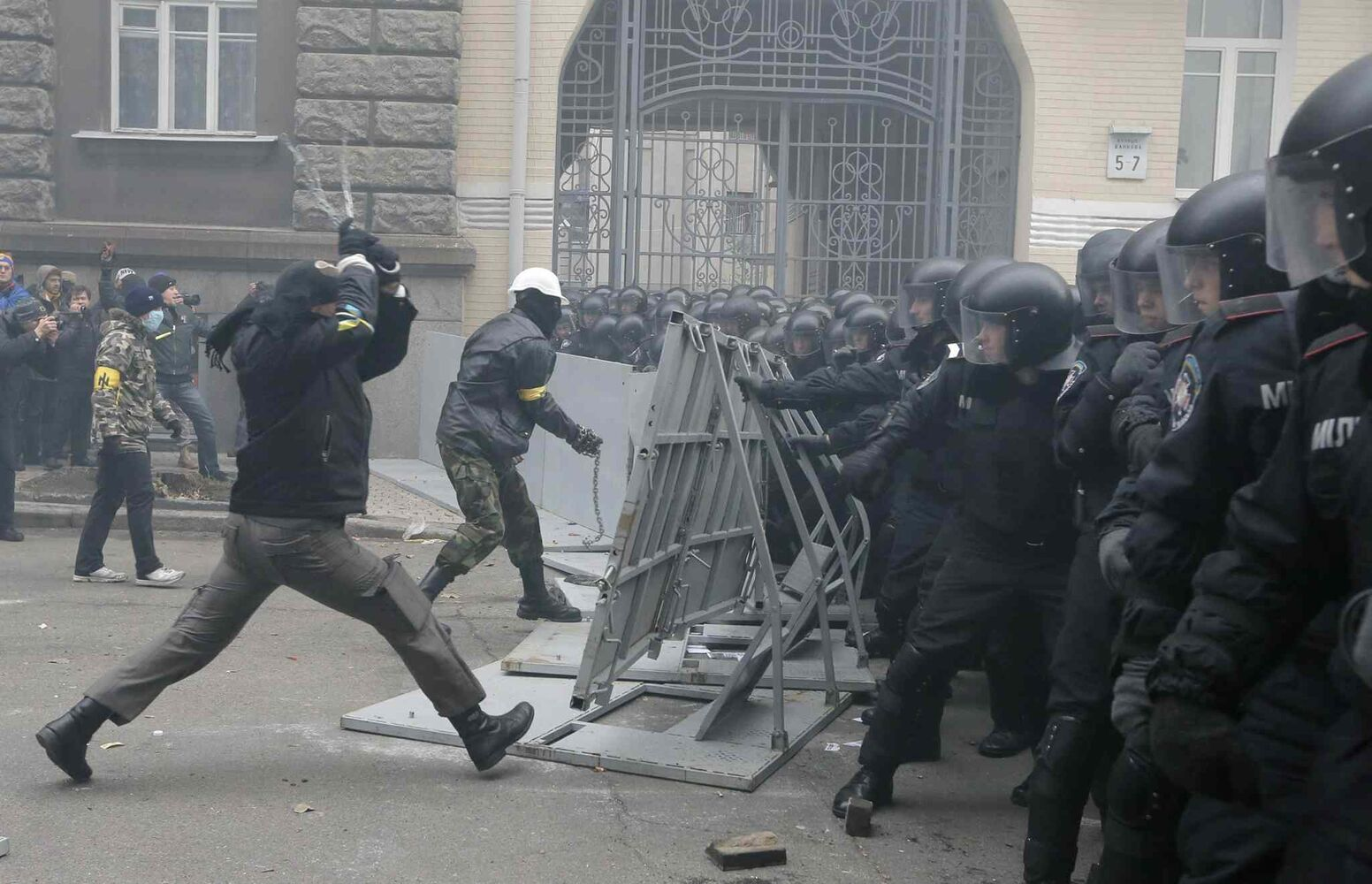 Protesters clash with police at the Presidential office in Kiev, Ukraine, on Sunday. As many as 100,000 demonstrators chased away police to rally in the center of Ukraine's capital on Sunday, defying a government ban on protests on Independence Square, in the biggest show of anger over the president's refusal to sign an agreement with the European Union.  (Efrem Lukatsky / The Associated Press)