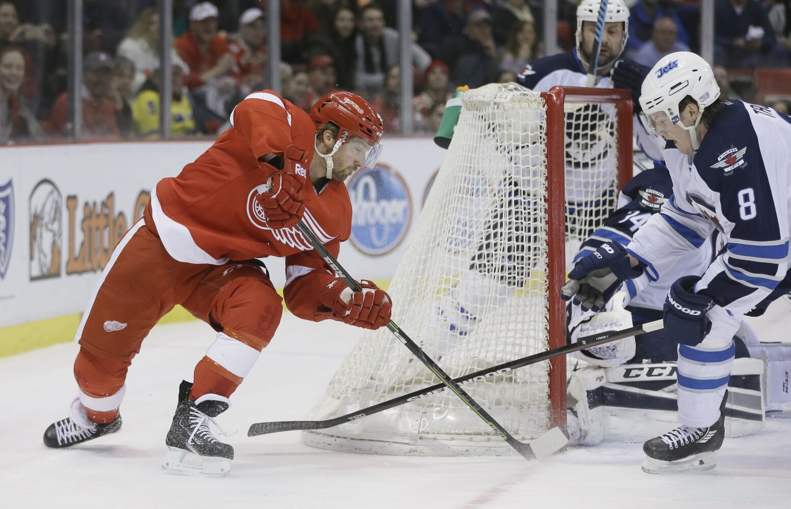 Darren Helm attempts a wrap-around on Jets goalie Michael Hutchinson.  (Carlos Osorio / The Associated Press)