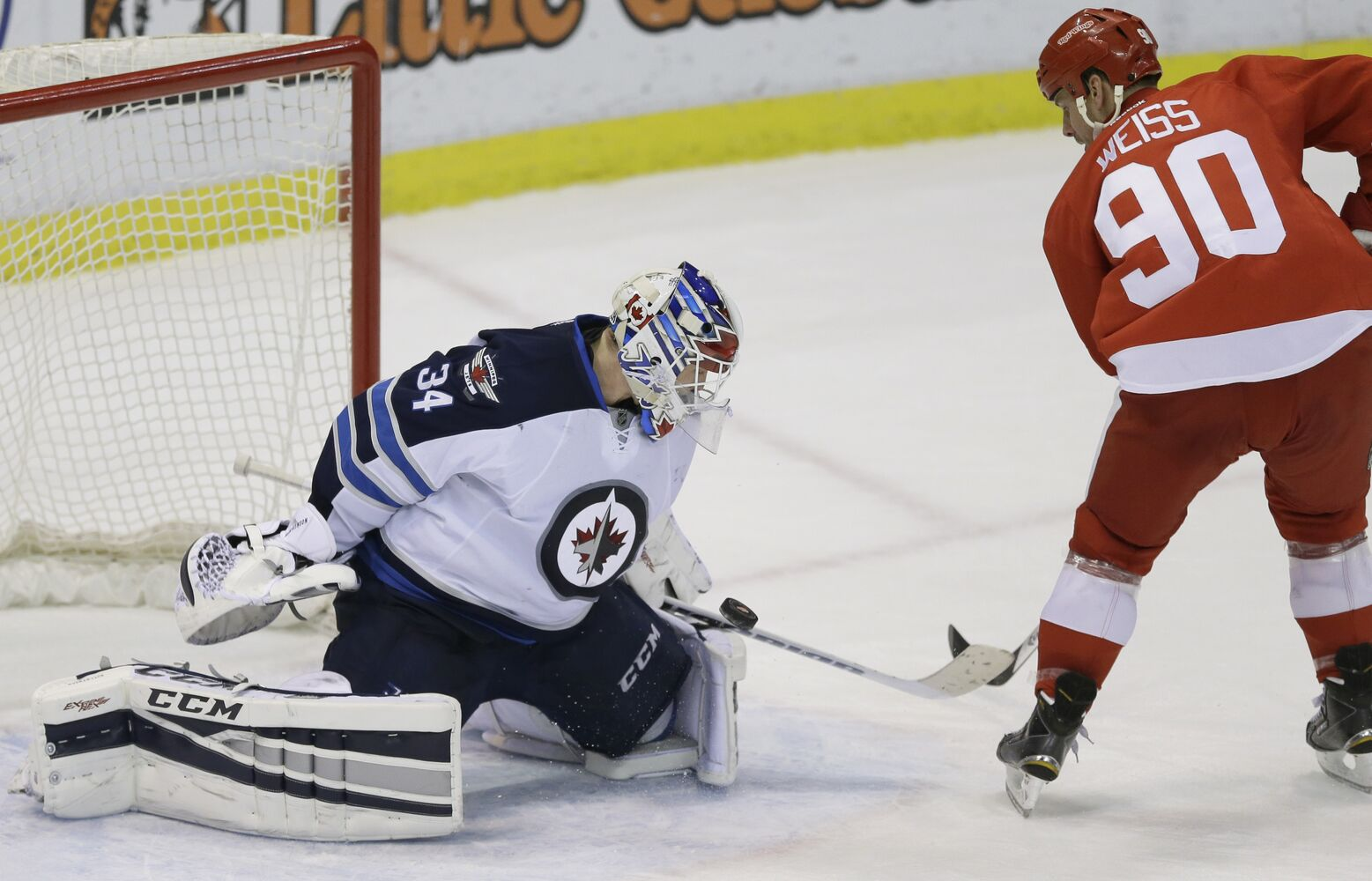 Jets goalie Michael Hutchinson stymies Red Wings centre Stephen Weiss during the shootout to clinch the win. (CP)