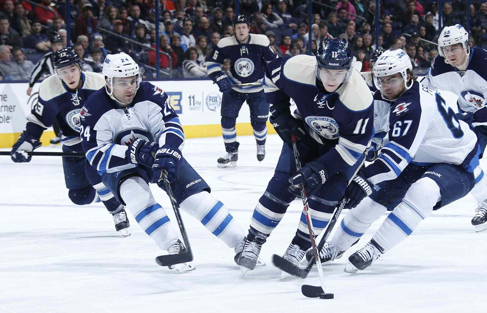 Blue Jackets left winger Matt Calvert (11) carries the puck into the Jets end Monday night.