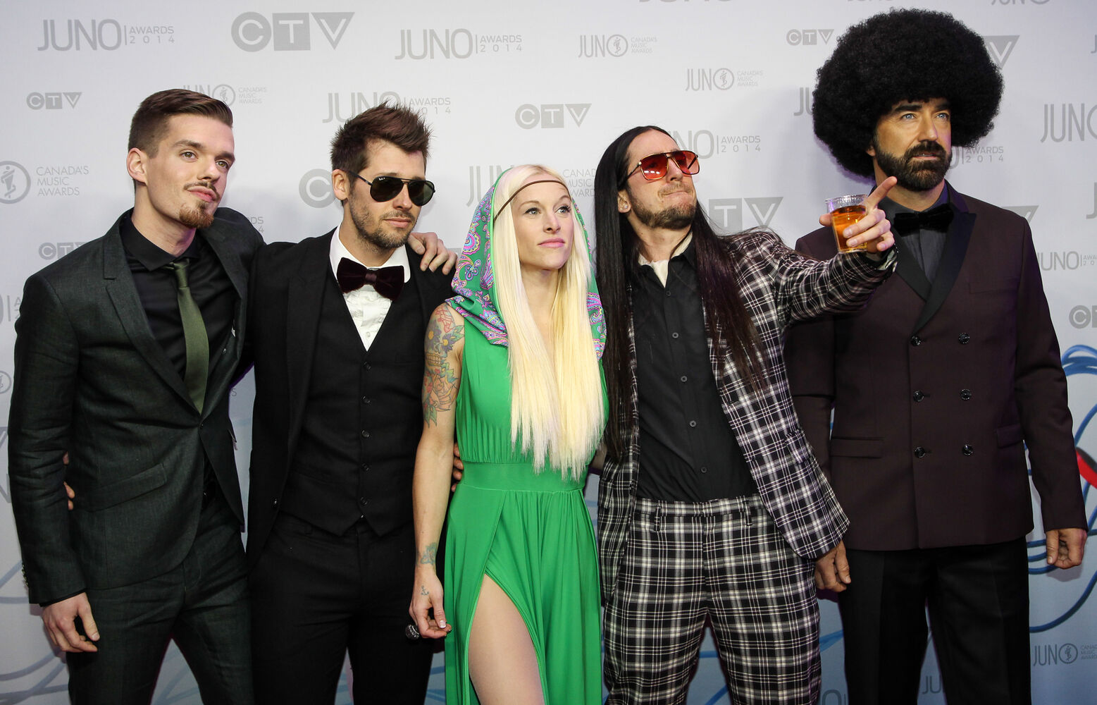 Juno nominees and performers Walk Off The Earth arrive on the 2014 Juno Awards red carpet.