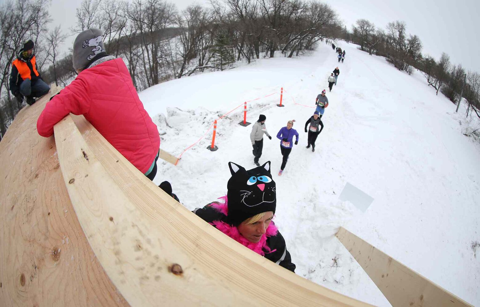Participants make their way over the Tower of Power obstacle during the Ice Donkey event.