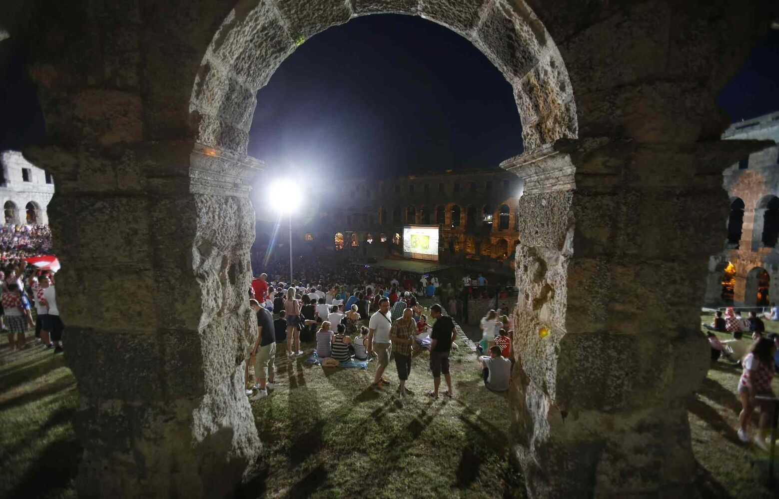 Croatian soccer fans watch the opening game of the World Cup between Brazil and Croatia in the Roman amphitheater in Pula, Croatia on Thursday. Pula's amphitheater is one of best preserved in the world.  (Darko Bandic / The Associated Press)