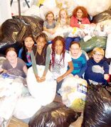École Robert Browning students show off the 31,000-plus bags they gathered in their most recent Bag Up campaign.
