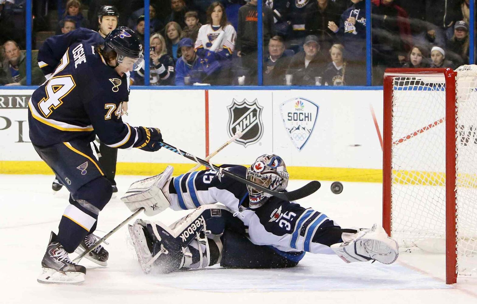 T.J. Oshie of the St. Louis Blues scores a shootout goal against Winnipeg Jets' goalie Al Montoya to win Saturday's game. (Chris Lee/St. Louis Post-Dispatch/MCT)