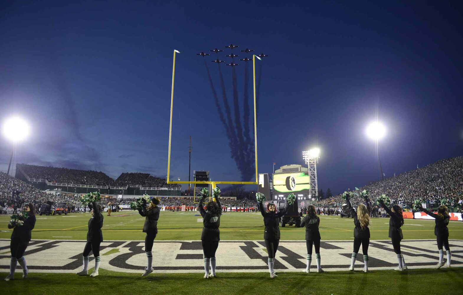 The Snowbirds fly over the field during pre-game ceremonies at the Grey Cup.