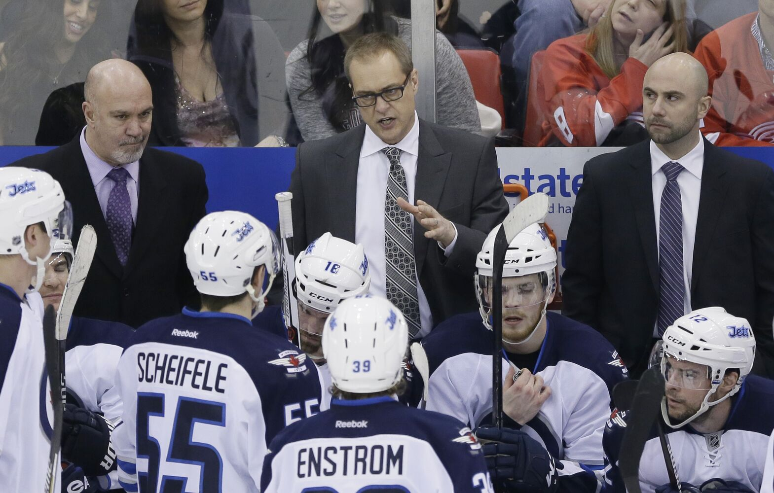 Jets coach Paul Maurice plots strategy with his team during a timeout. (Carlos Osorio / The Associated Press)