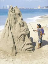 A local artist works on his elaborate sand sculpture near the centre of Puerto Vallarta.