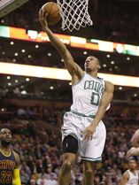 Boston Celtics guard Avery Bradley (0) drives toward the basket as Cleveland Cavaliers forward LeBron James (23) looks on in the first quarter of a first-round NBA playoff basketball game in Boston, Sunday, April 26, 2015. (AP Photo/Steven Senne)