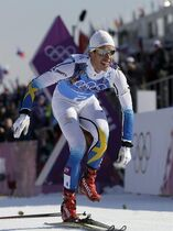 Sweden's Marcus Hellner takes off his skis to celebrate winning the gold medal in the men's 4x10K cross-country relay at the 2014 Winter Olympics, Sunday, Feb. 16, 2014, in Krasnaya Polyana, Russia. (AP Photo/Felipe Dana)