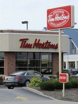 A Tim Hortons restaurant is seen on W. 26th Street in Millcreek Township, Pa., on Tuesday, Aug. 26, 2014. Burger King struck an $11 billion deal to buy Tim Hortons that would create the world's third largest fast-food company and could make the Canadian coffee-and-doughnut chain more of a household name around the world. (AP Photo/Erie Times-News, Christopher Millette)
