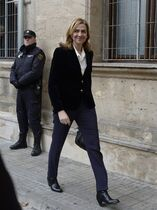FILE - In this Feb. 8, 2014 file photo, Spain's Princess Cristina arrives at the courthouse of Palma de Mallorca in Palma Mallorca, Spain. A Spanish judge on Monday Dec. 22, 2014 has ordered Princess Cristina to be tried along with her husband on charges of tax fraud, marking the first time that a member of the country's royal family heads to court since the royalty was restored in 1975. The legal troubles of King Felipe VI's sister during a four-year probe have damaged the Spanish monarchy's image. (AP Photo/Manu Fernandez, File)