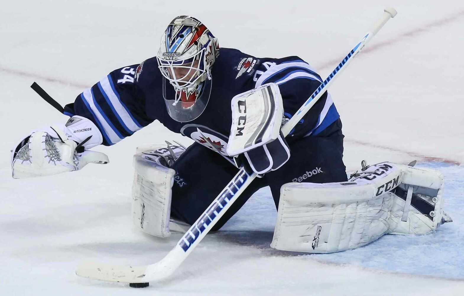 Winnipeg Jets' goaltender Michael Hutchinson jumps on this puck and stops all second-period shots from the Boston Bruins. The score remained 1 to 0 for the Bruins after two.  (Crystal Schick/Winnipeg Free Press)