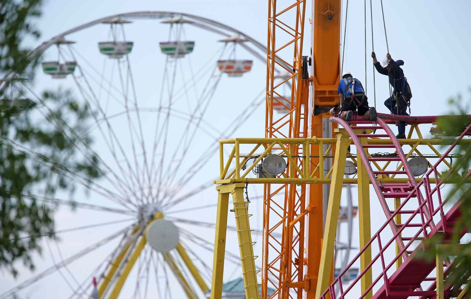 Workers assemble part of the Crazy Mouse Rollercoaster at Red River Exhibition Park prior to the Ex, which runs June 13 to June 22. (TREVOR HAGAN/WINNIPEG FREE PRESS)