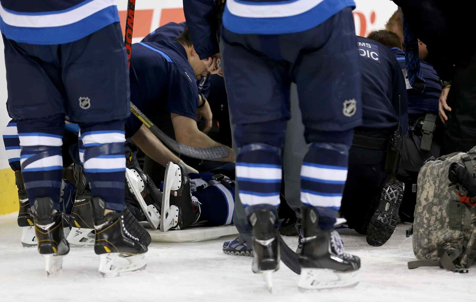Winnipeg Jets' Jacob Trouba is attended to by medical personnel on the ice. (TREVOR HAGAN / WINNIPEG FREE PRESS)