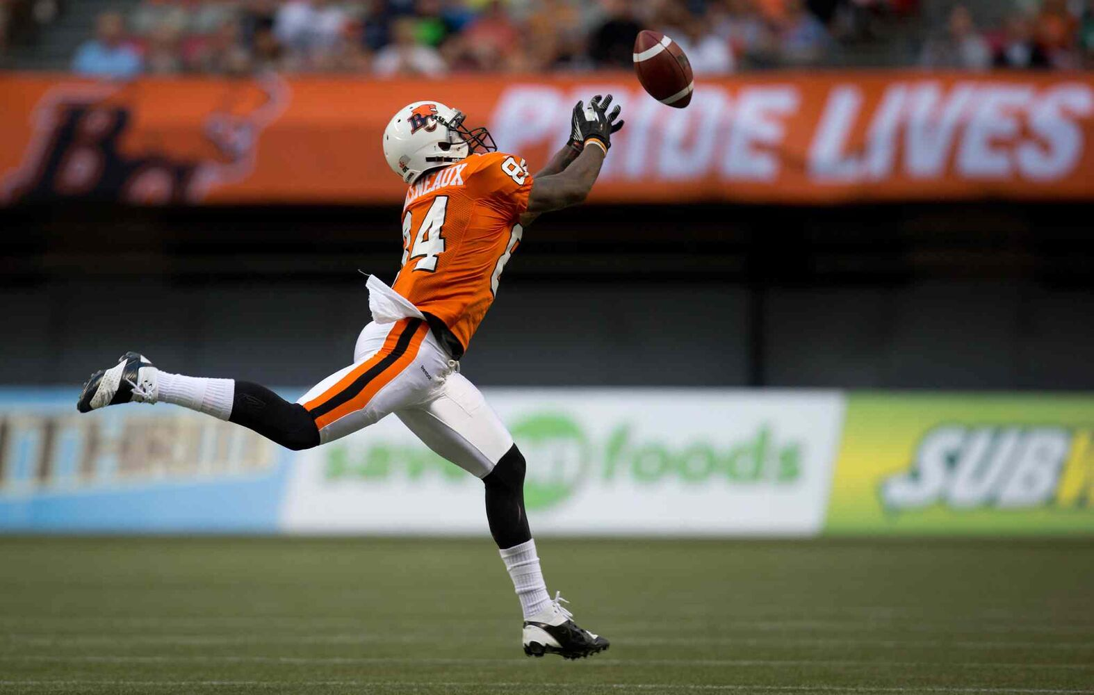 B.C. Lions' Emmanuel Arceneaux reaches but fails to make the reception during the first half of Friday's game. (DARRYL DYCK / THE CANADIAN PRESS)