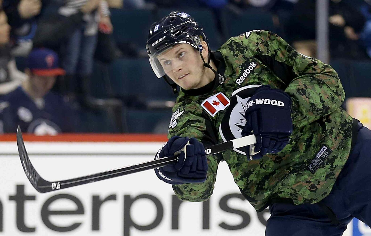 Winnipeg Jets' Jacob Trouba (8) fires a shot during warmup while wearing a camouflage jersey on Military Appreciation day prior to the game against the Ottawa Senators', Saturday. (TREVOR HAGAN / WINNIPEG FREE PRESS)