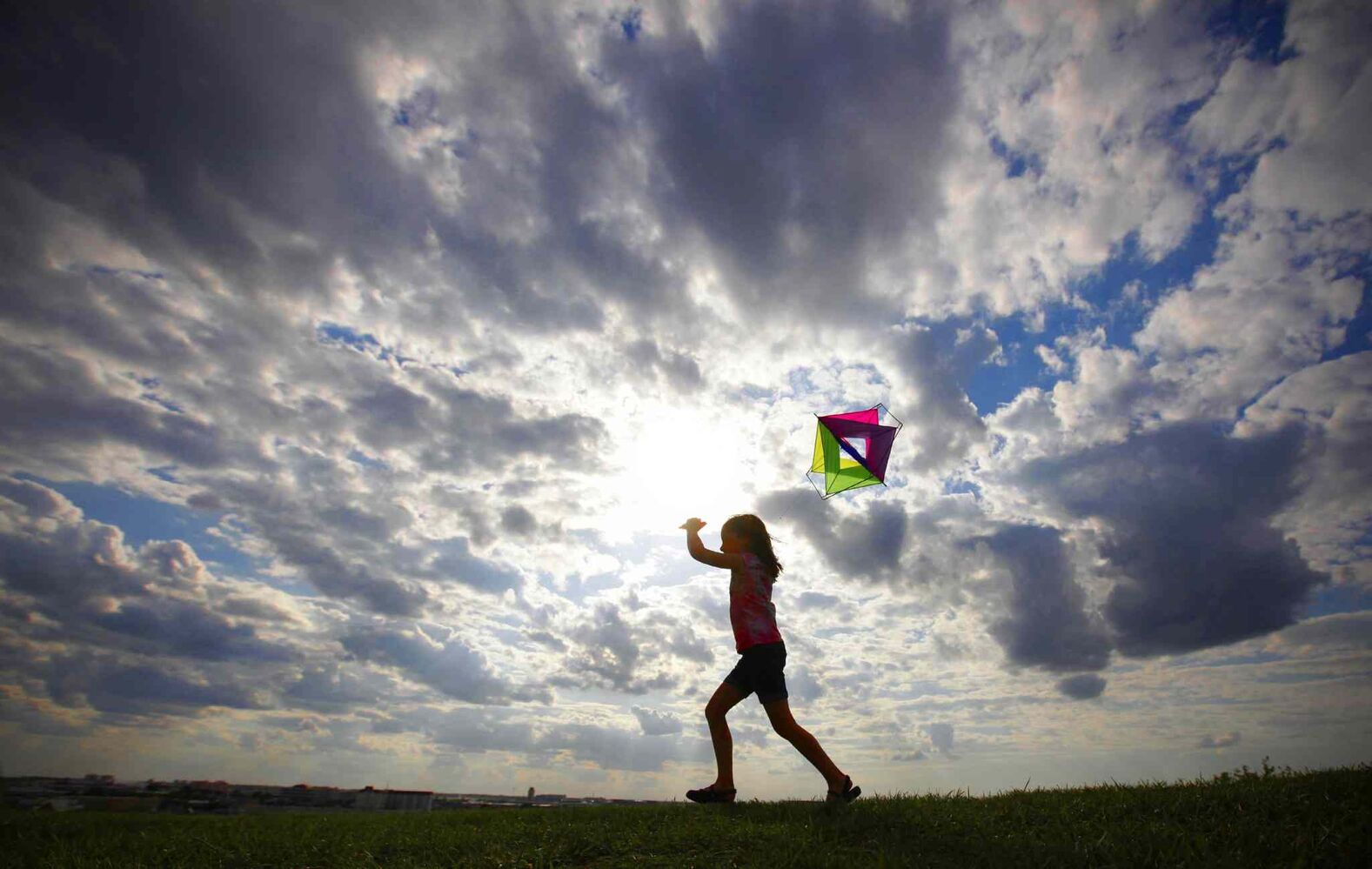 Fiona Nixon (8) was out flying her kite with her mom and sister at Westview Park (Garbage Hill) Tuesday, June 18, 2013.