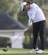 Lydia Ko, of New Zealand, hits from the ninth tee during the third round of the LPGA's Coates Golf Championship, Friday, Jan. 30, 2015, in Ocala, Fla. (AP Photo/The Star-Banner, Bruce Ackerman)