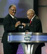 Frank Scott, left, and Wendell Scott Jr. admire a ring as they induct their father, Wendell Scott, into the NASCAR Hall of Fame Friday, Jan. 30, 2015, in Charlotte, N.C. Scott died in 1990.(AP Photo/Nell Redmond)
