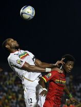 Mali's Seydou Keita, left, wins the header against Guinea's Ibrahima Conte, right, during the African Cup of Nations Group D soccer match between Guinea and Mali, in Mongomo, Equatorial Guinea, Wednesday, Jan. 28, 2015. (AP Photo/Themba Hadebe)