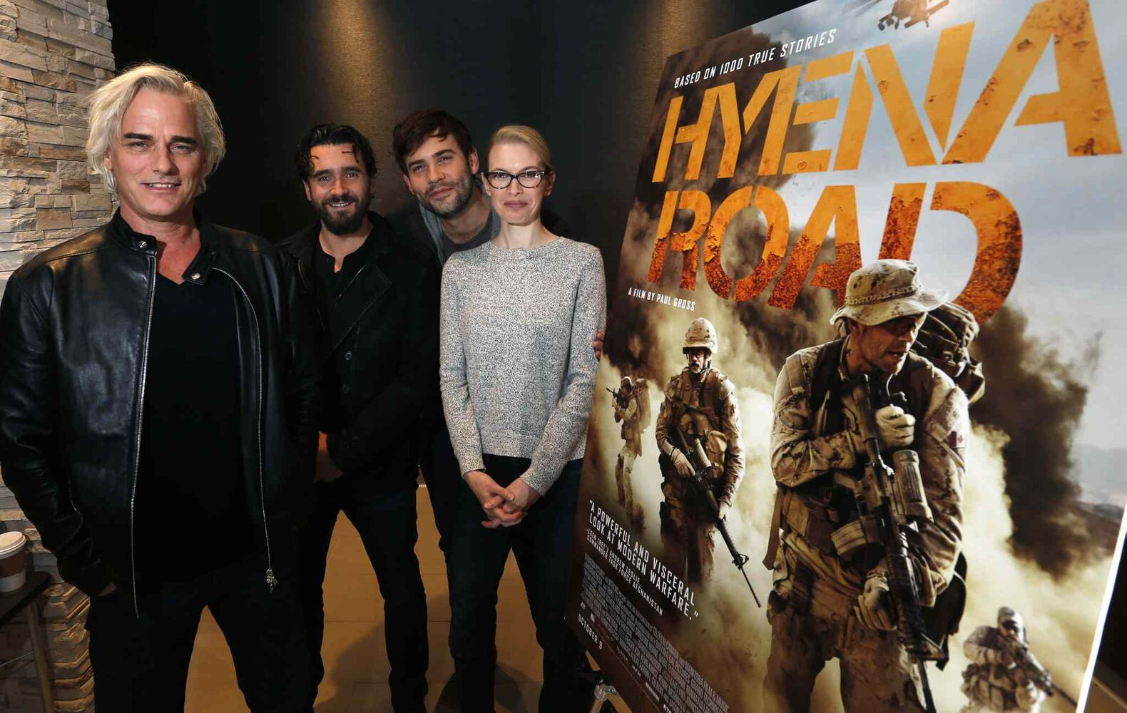 From left, Paul Gross, director, writer and stars in the movie Hyena Road with actors  Allan Hawco , Rossif Sutherland and Christine Horne at the Grant Park Cinemas Wednesday for media interviews. (Wayne Glowacki / Winnipeg Free Press)