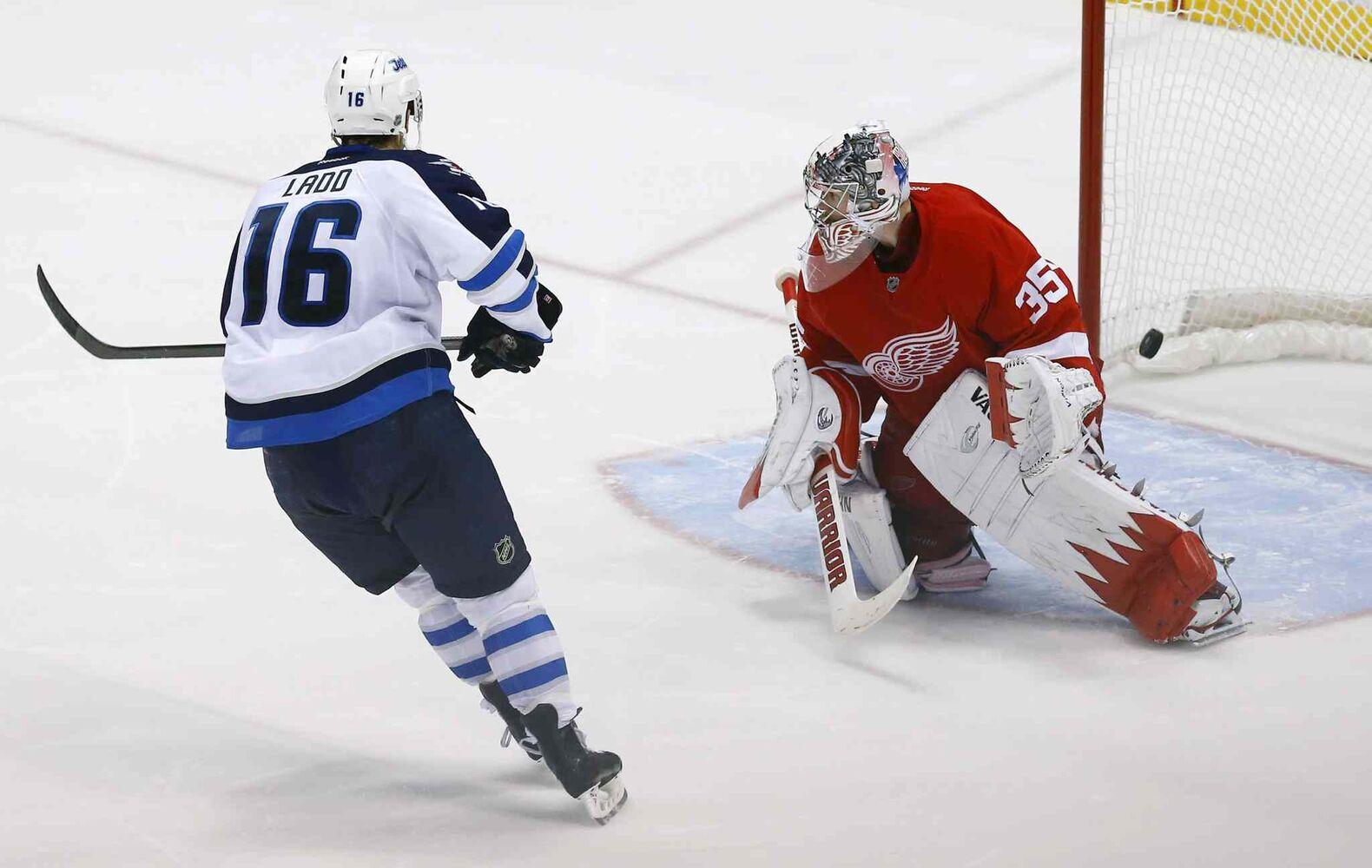 Winnipeg Jets captain Andrew Ladd scores the deciding goal against Detroit Red Wings goalie Jimmy Howard in the shootout goal, giving the Jets a 3-2 win. (PAUL SANCYA / THE ASSOCIATED PRESS)
