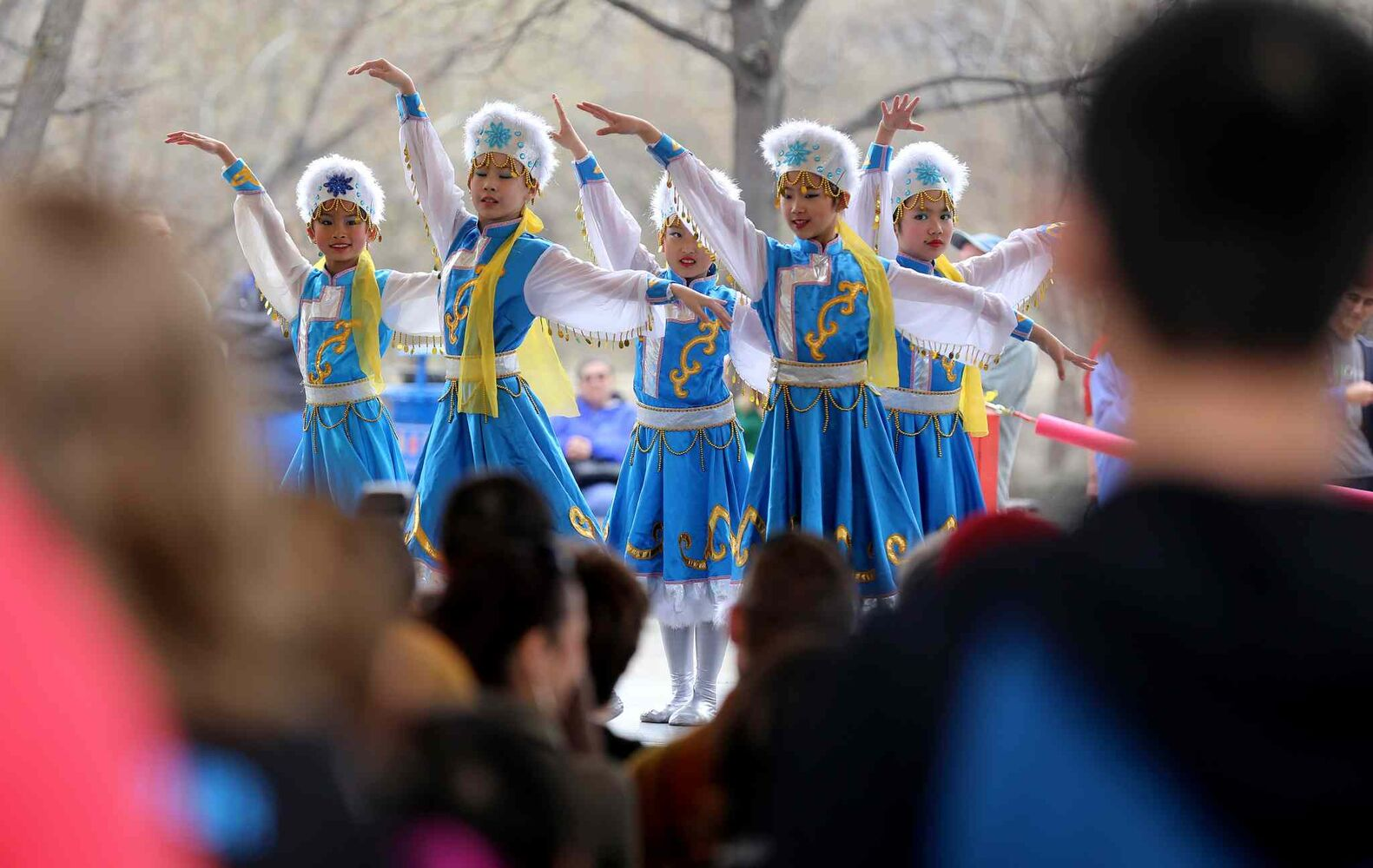 Spectators enjoy a performance by the Great Wall Performing Arts school  during Asian Heritage Month celebrations at The Forks, Sunday. (TREVOR HAGAN / WINNIPEG FREE PRESS)