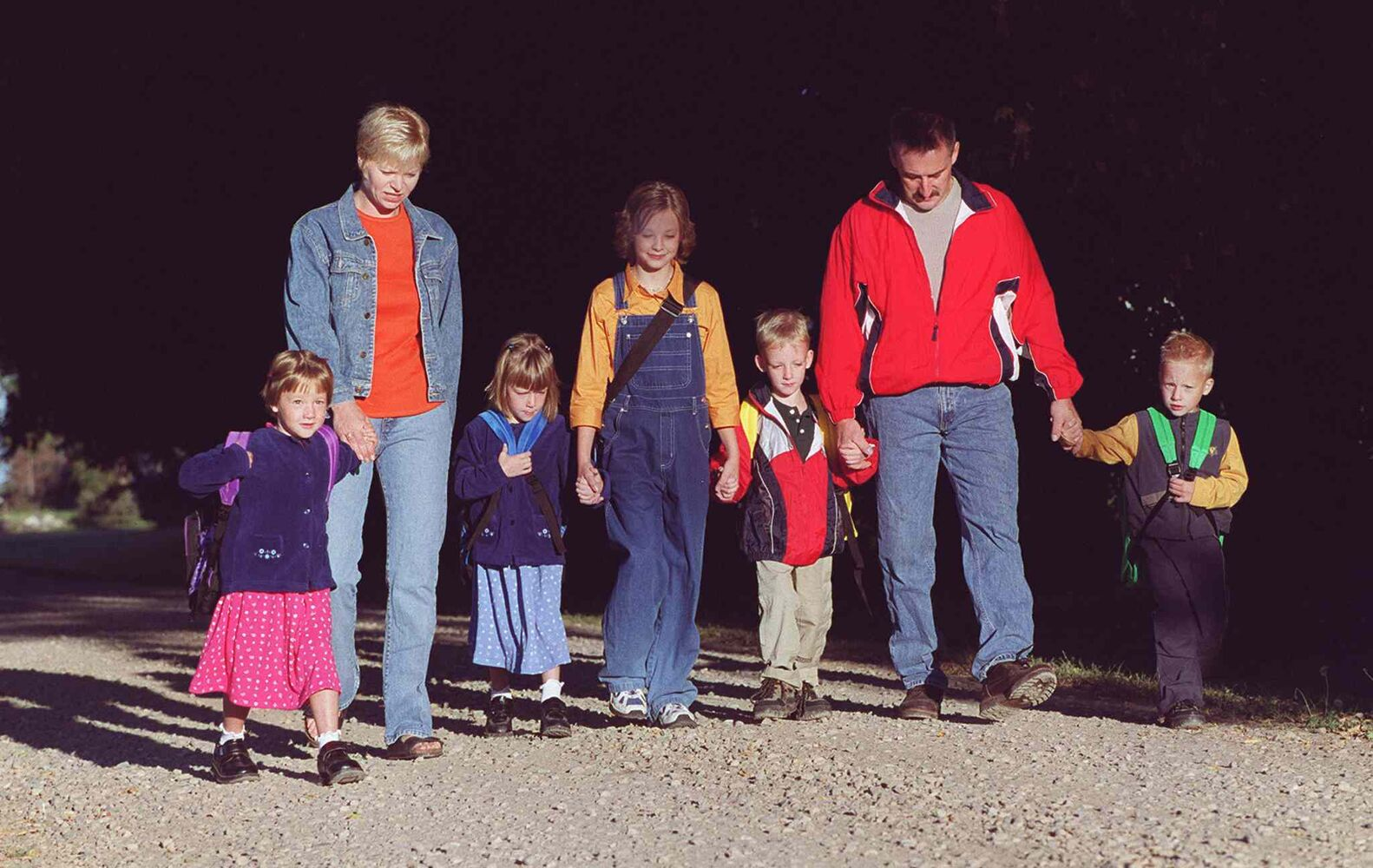 From left, Janelle, Mom Heather, Maryn, big sister Caitlyn, Greg, Dad Ed, and Myles Lavich walk up their road to meet the school bus for the quadruplets' first day of kindergarten.