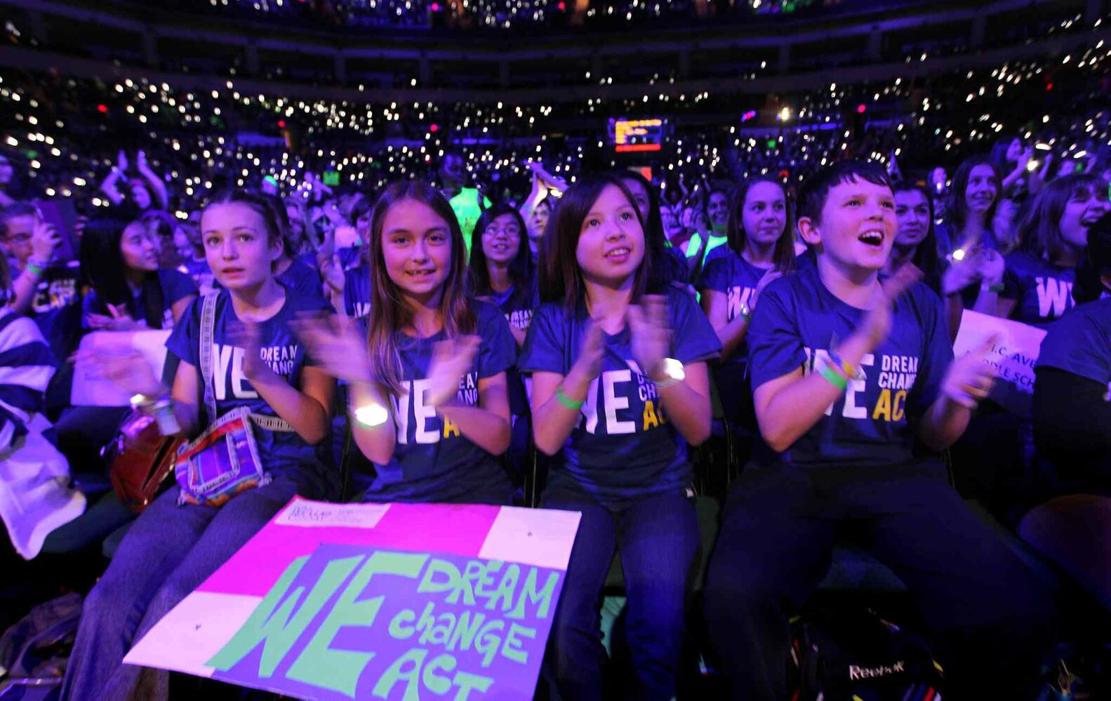 Students from H.C Avery School celebrate the events on stage. (Ruth Bonneville / Winnipeg Free Press)