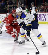 Carolina Hurricanes goalie Cam Ward, rear, and teammate Ryan Murphy (7) defend the goal against St. Louis Blues' Joakim Lindstrom (10), of Sweden, during the first period of an NHL hockey game in Raleigh, N.C., Friday, Jan. 30, 2015. The Toronto Maple Leafs traded their final pending unrestricted free agent by sending Olli Jokinen to the St. Louis Blues.The Leafs received Lindstrom and a conditional sixth-round pick. THE CANADIAN PRESS/AP Photo/Gerry Broome