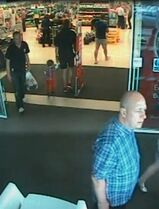 In this image made available by South Wales Police shows a video image Alan Knight,of Swansea south Wales, right, in a supermarket in Bishop�s Cleeve in western England in June 2014. Alan Knight a fraudster who pretended to be quadriplegic and sometimes comatose for two years to avoid prosecution has been convicted after police caught him on camera driving and strolling around supermarkets. Alan Knight of Swansea, Wales, stole more than 40,000 pounds ($64,000) from the bank account of an elderly neighbor with Alzheimer's disease, prosecutors said. (AP Photo/South Wales Police)